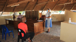 Prof Modise and Kgosi presenting the project in the Kgotla, which is the space where public meetings, community council or traditional law court are held in Botswana villages.